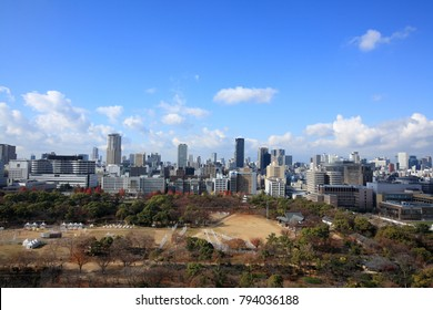 Osaka City Scenery, Japan- December,2017 : There are many modern buildings, shopping streets and historical landmarks such as Osaka Castle, temples, canal, etc. This photo was taken from Osaka Castle.
