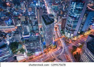 Osaka city skyline - asia modern business city, cityscape birds eye view in evening, shot in Osaka ekimae daisan (third) building, Osaka, Japan.