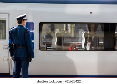 OSAKA - DEC 9 ,2017 : A railway station attendant Pusher JR Osaka Station waits for a subway operated by West Japan Railway Company (JR West).