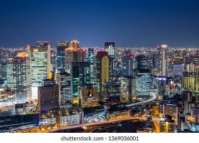 Osaka downtown skyline from Umeda sky building at night, Japan
