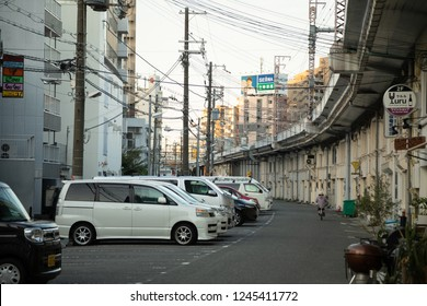 Osaka, Fukushima / Japan - October 3 2018:  Curved side street along a raise highway viaduct
