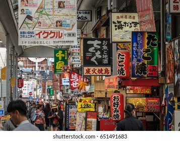 Osaka, Japan - 11. May 2017 - Dense advertisement in Japan. Every free space is filled with a sign.