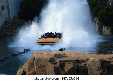 Osaka, Japan - 15 DEC 2017: A lot of tourists with massive splash water from Jurassic park ride at Universal Studios Japan.