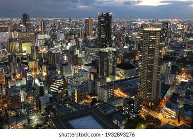 Osaka, Japan - 16 november 2016: Aerial view of Osaka city from Umeda Sky Building at sunset.