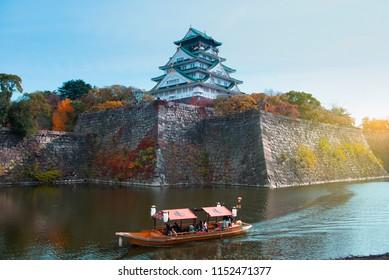 Osaka, Japan : 25-November-2017 : Tourists are sightseeing on the boat while traveling at Osaka castle during autumn in Osaka, Japan.