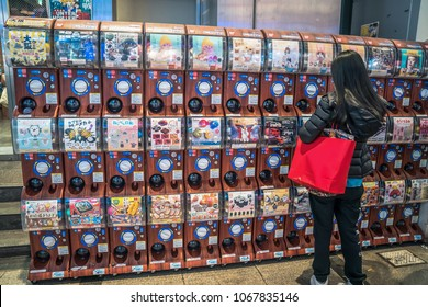 Osaka, Japan - 28 Feb 2018: Gashapon or Gachapon machine arrange in the line, it is the random premium toy in plasti ccapsule. Drop coin & twist rolling bottom then it will drop out.