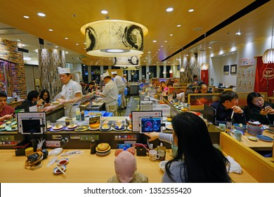OSAKA, JAPAN -28 FEB 2019- View of a kaiten carousel sushi restaurant, where food is served on small colored plates, in Osaka, Japan.