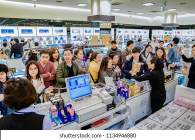 Osaka, Japan - 4 Mar 2018: Tourists and Travelers listen and negotiate with sales in duty free shop, Oaska, Japan.