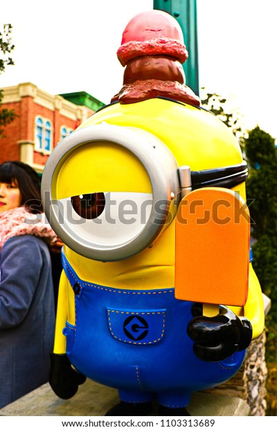 """OSAKA, JAPAN - Apr 13, 2018 : Statue of """"HAPPY MINION"""", located in Universal Studios Japan, Osaka, Japan. Minions are famous character from Despicable Me animation."""