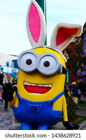 OSAKA, JAPAN - Apr 13, 2019 : Close up of HAPPY MINION statue, located in Universal Studios Japan. Minions are famous character from Despicable Me animation.