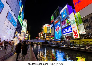 Osaka, Japan - April 1, 2017: Dotonburi district  is famous for shopping street, entertainment and food. Many tourist come here to see fun night life ant take picture with Gilico running man sign.
