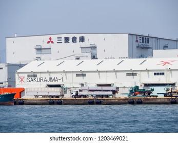 OSAKA, JAPAN - APRIL 10, 2018: Wide view of the Mitsubishi Sakurajima warehouse next to a port near Aji River, Osaka Bay. Multinational corporation and industries.