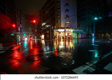 Osaka, Japan - April 14, 2018: A quiet intersection in heavy rain