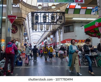 "OSAKA, JAPAN - APRIL 15: Visitors visit Kuromon Ichiba Market on April,15,2018 in Osaka,Japan. It's a very popular area known by locals as ""Gastronome"" and ""Osaka' s Kitchen"", is well-known nationwide"