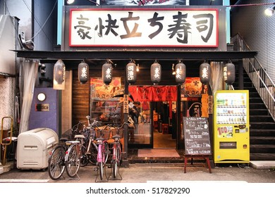 OSAKA, JAPAN - APRIL 25, 2012: People visit Japanese restaurant in Osaka. Japan has a very pro-restaurant culture, there are 474,000 restaurants in Japan.