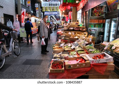 OSAKA, JAPAN - APRIL 25: Shoppers walk along Nipponbashin Kuromon market on April 25, 2012 in Osaka, Japan. According to Tripadvisor, it is currently among best 3 shopping places in Osaka.