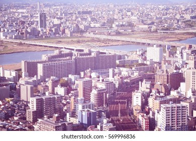 OSAKA, JAPAN - APRIL 27, 2012: Cityscape view on April 27, 2012 in Osaka, Japan. Osaka is the 3rd largest city in Japan (2.8 million people) with population of metro area reaching 19 million people.