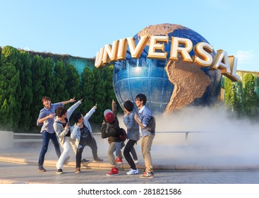 Osaka, Japan - April 27: Tourists and Universal Globe outside the Universal Studios Theme Park in Osaka, Japan on April 27, 2015. The theme park has many attractions based on the film industry