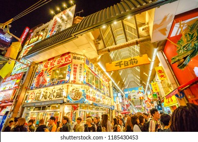 Osaka, Japan - April 29, 2017: crowd of people for Golden Week at entrance of Ebisu Bashi-Suji Shopping Street with its colorful neon in Namba District, one of main tourist destinations in Osaka.