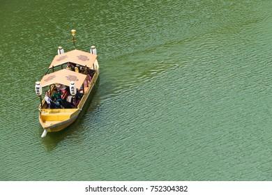 OSAKA, JAPAN - APRIL 29 : The tourists are traveling on the golden vintage Japanese boat along the lake around the Osaka castle  on April 29, 2017 in Osaka, Japan