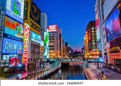 OSAKA, JAPAN - APRIL 6 : Japanese people wander in Dotonbori area of Osaka after work on April 6 2012. Dotonbori is an entertainment area of Osaka famous for its neon signs.