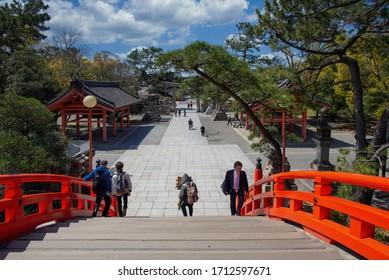 OSAKA, JAPAN - April 9, 2019 : Red curve bridge in the river at Sumiyoshi Taisha Shrine. in Osaka, Japan.