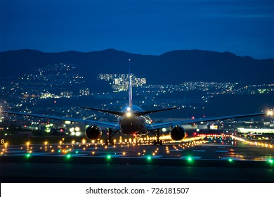 OSAKA, JAPAN - Aug. 14, 2017: Boeing airplane taking off from the Itami International Airport in Osaka, Japan in the night.