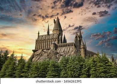 OSAKA, JAPAN - AUGUST 10, 2019:   Hogwarts Castle on sun set. The Wizarding World of Harry Potter in Universal Studios Japan. Universal Studios Japan is a fun and famous theme park in Osaka, Japan.