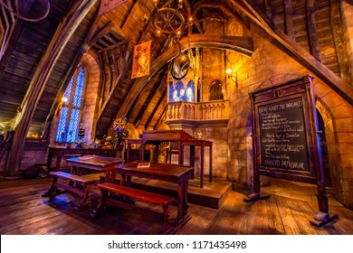 OSAKA, JAPAN - AUGUST 12, 2018: This is the defense against the dark arts classroom. Harry, Ron, and Hermione will come out from under an invisibility cloak which is a 3D hologram projection form.