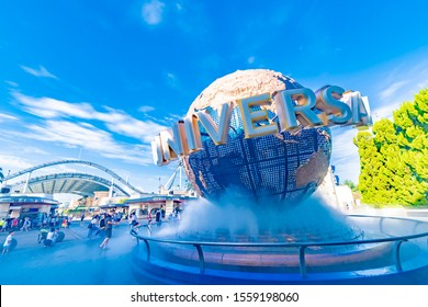 OSAKA, JAPAN - August 12, 2018. Tourists and theme park visitors front of rotating globe fountain in front of Universal Studios. Universal Studios Japan is a fun and famous theme park in Osaka, Japan.