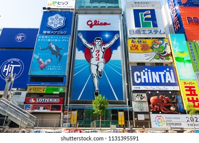 Osaka, JAPAN - CIRCA June, 2018:Dotonbori district surrounding of advertisements sign at Namba area, with beautiful cloud sunny day in Osaka City, Japan