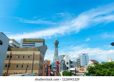 Osaka, JAPAN - CIRCA June, 2017:Tsutenkaku Tower  is a tower and well-known landmark of Osaka, Japan and advertises Hitachi, located in the Shinsekai district of Naniwa-ku, Osaka.