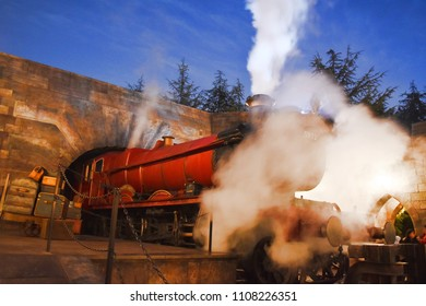 OSAKA, JAPAN - DEC 23, 2017 : Hogwarts Express locomotive is covered by steam as the scene of Harry Potter in Universal Studios Japan with clear night sky as background