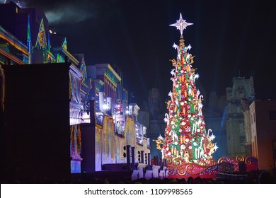 OSAKA, JAPAN - DEC 23, 2017 : huge twinkle Christmas tree is decorated with illuminated buildings and clear night sky as background