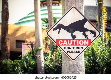 Osaka, Japan - December 08 2016, Jurassic park dinosaur caution sign with raptor picture in Universal Studios Japan.