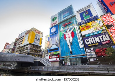 OSAKA, JAPAN - DECEMBER 1 : Japanese people wander in Dotonbori area of Osaka after work on December 1 2012. Dotonbori is an entertainment area of Osaka famous for its neon signs.