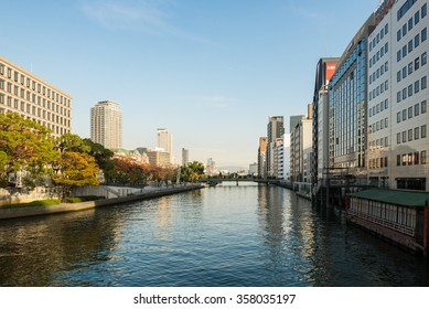 OSAKA, JAPAN - DECEMBER 2, 2015: Office buildings of Nakanoshima district and Tosabori river.