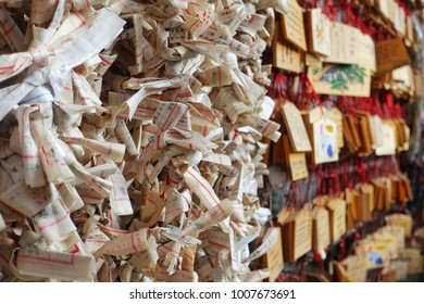 Osaka, Japan - December 26, 2017 : Omikuji and blur background Ema is the traditional culture when Japanese people go to shrine.  Omikuji is the Japanese fortune bills which tell the coming future.