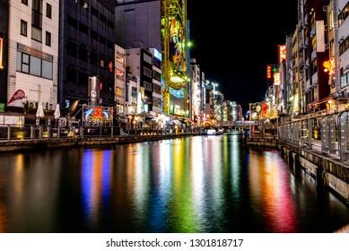 OSAKA, JAPAN - DECEMBER 28, 2018 : Dotonbori's one of the principal tourist destinations in Osaka, Japan. Canal from Dotonbori bridge to Nipponbashi bridge, a popular nightlife and entertainment area.