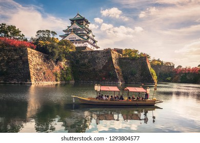 OSAKA, JAPAN - DECEMBER 5, 2018: Touristic boat with tourists along the moat of Osaka Castle is one of the best activities you can experience around Osaka Castle area, Osaka, Japan.