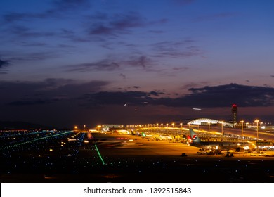 Osaka, Japan. December 5, 2018. Aircraft of Many Airlines Parking at Gate Terminal for Borading Passenger at Osaka Kansai International Airport with Beautiful Blue Sky and Twilight at Night.Copy Space
