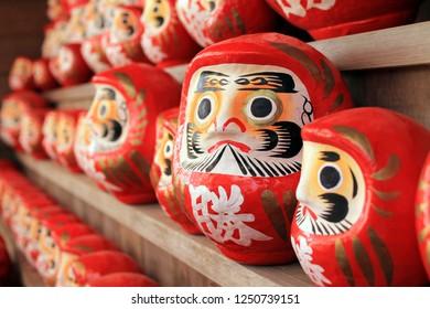 "Osaka, Japan - December 6, 2018 : Various Size of Daruma Dolls at Katsuouji Temple in Osaka / Japanese Word ""Win"""