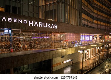 Osaka, Japan - December 6, 2018: Holiday lights adorn the base of Abeno Harkukas, the tallest building in Japan