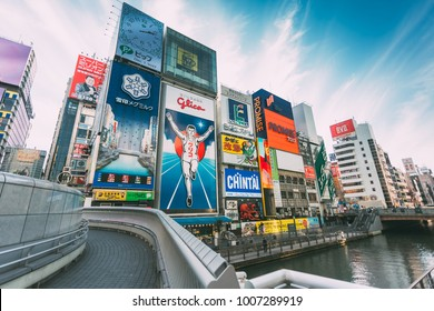 OSAKA, JAPAN - DECEMBER 7, 2017: Unidentified people tourist walking around of Dotonbori district surrounding of advertisements sign at Namba area, with beautiful cloud sunny day in Osaka City, Japan