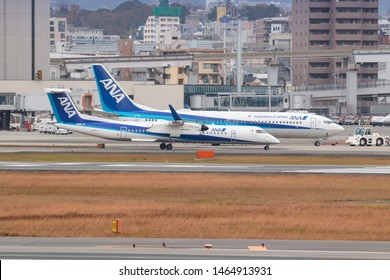 Osaka, Japan. December 7, 2018. ANA Wings De Havilland Canada DHC-8-400 Reg. JA847A Taxi to Gate Terminal after Land at Osaka Itami International Airport with Boeing 737 Same Company Background.