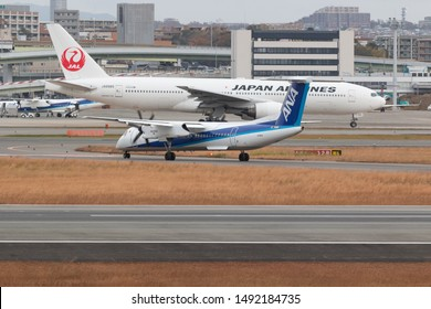 Osaka, Japan. December 7, 2018. ANA Wings De Havilland Canada DHC-8-400 Reg. JA465A Landing at Osaka Itami International Airport.