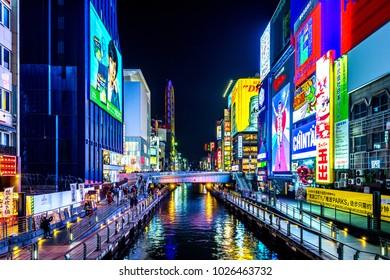 OSAKA, JAPAN - FEB 15, 2018 : Tourist walking in night shopping street at Dotonbori in Osaka, Japan  on February 15,2018