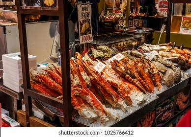 Osaka, Japan, Feb 9th 2018 : Kuromon Ichiba is a lively covered market which stretches for 580 meters in OsakaChuo Ward, Nicknamed as Osaka kitchen by local chef,has recently become a popular tourist