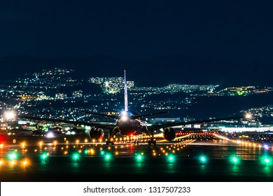 OSAKA, JAPAN - JAN. 2, 2019: ANA Boeing airplane taking off from the Itami International Airport in Osaka, Japan in the night.