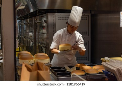 OSAKA, JAPAN - JAN 29, 2018: Pastry chef cooking the famous japanese sponge cake in Rikuro Ojisan store isolated